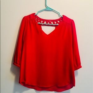 A. Byer red v-neck blouse